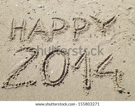 Happy 2014 written on beach sand