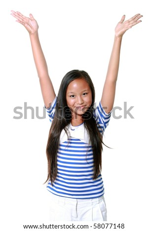 Happy 10-year old asian girl with hands in the air, isolated on white background - stock photo