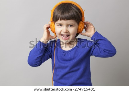 happy 4-year old preschool girl enjoying a groovy stereo - stock photo
