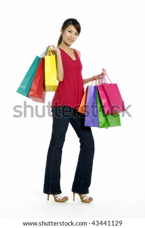 happy young adult girl with colored bags - stock photo