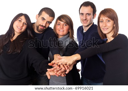Happy Young Adult People with Hands on Stack - stock photo
