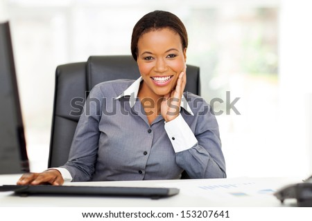 happy young african american businesswoman relaxing in office - stock photo