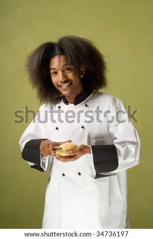 Happy Young African American Chef Peeling a Potato - stock photo
