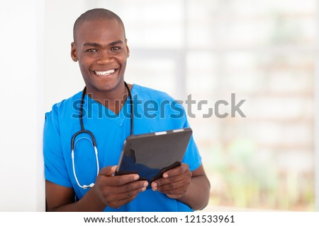 happy young african american health care worker with tablet computer - stock photo