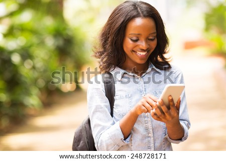 happy young african american uni student using cell phone - stock photo