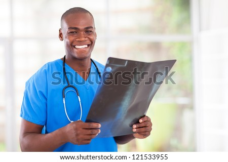 happy young african medical worker with x-ray - stock photo