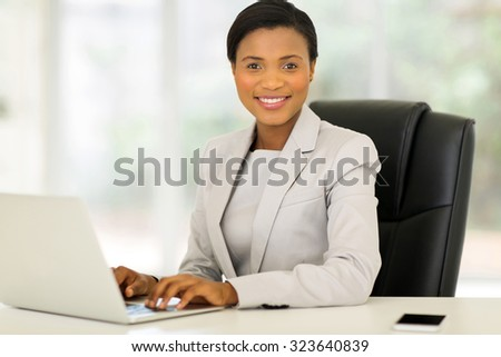 happy young afro american businesswoman working on laptop