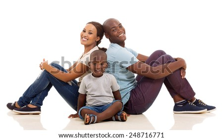 happy young afro american family sitting on the floor isolated on white background - stock photo