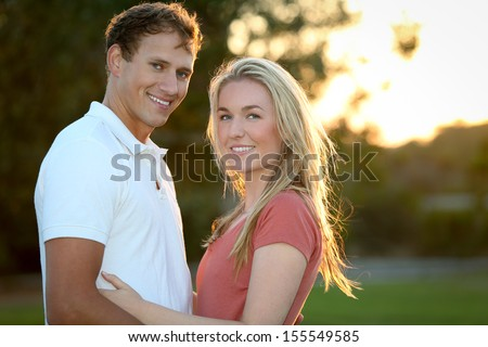 Happy young and attractive couple - stock photo