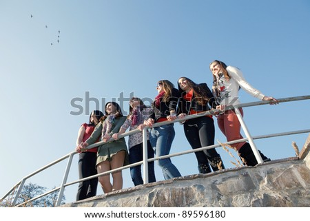 happy young and attractive girlfriends - stock photo