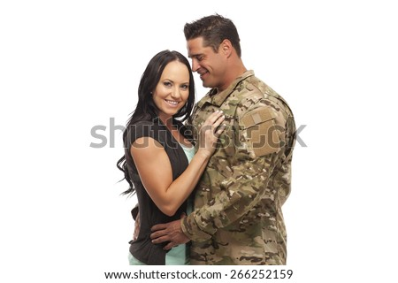 Happy young army man embracing his wife against white background - stock photo