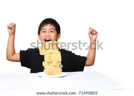 Happy young asian boy with bread - stock photo