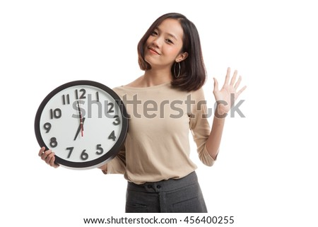 Happy Young Asian business woman with a clock  isolated on white background