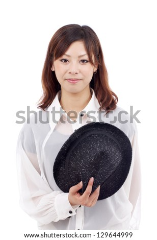 Happy young asian girl holding hat, smiling, looking at camera, on white background - stock photo