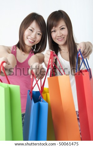 happy young asian girls shopping with bags - stock photo