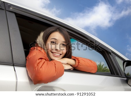 happy young asian woman in the car