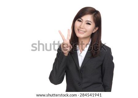 Happy young asian woman showing two fingers or victory gesture with blank copyspace area for text,Portrait of beautiful Asian woman,Thai girl,Positive emotion expression,isolated on white background - stock photo