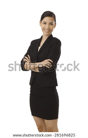 Happy young Asian woman standing arms crossed, smiling in black costume. - stock photo