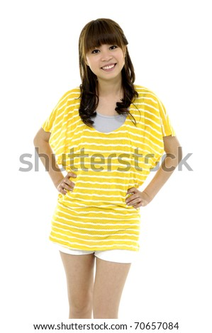 Happy young asian woman standing full length isolated on white background - stock photo