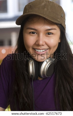 Happy Young attractive female Asian girl with big smile