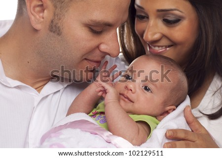 Happy Young Attractive Mixed Race Couple with Newborn Baby. - stock photo