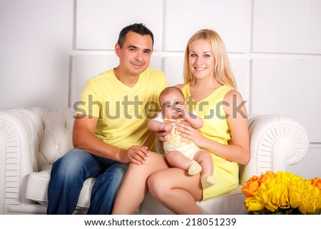 Happy Young Attractive Mixed Race Family with Newborn Baby.  - stock photo