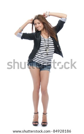 Happy young beautiful full body brunette woman dancing in casual cloth smiling on a white background - stock photo