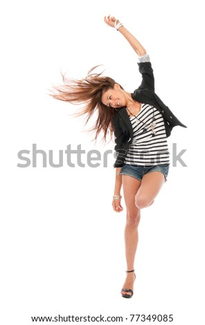 Happy young beautiful full body brunette woman dancing in casual cloth with windy hair isolated on a white background - stock photo
