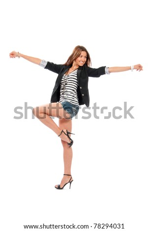 Happy young beautiful full body brunette woman dancing in casual cloth with windy hair on high hills isolated on a white background - stock photo