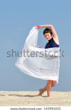 happy young beautiful girl on the beach with a white cloth - stock photo