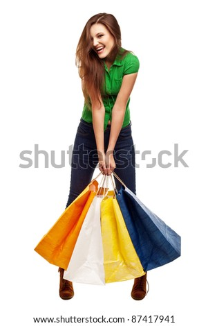 happy young beautiful girl with the bags against a white background - stock photo