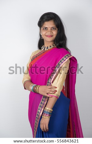 Happy young beautiful Indian woman in saree.