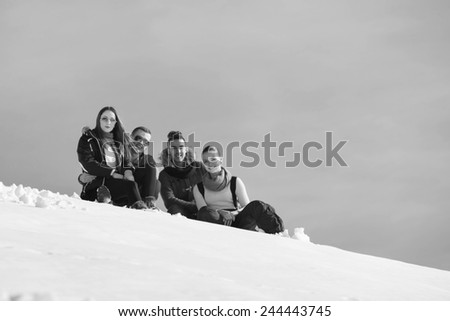 happy young beautiful people group have fun and enjoy fresh snow at beautiful winter day - stock photo