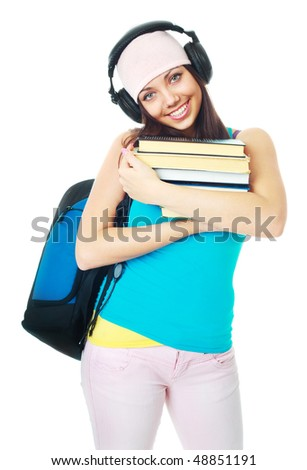 happy young beautiful student wearing earphones and holding books - stock photo