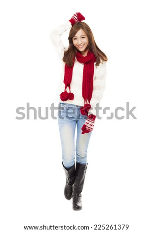 happy young beautiful woman in winter clothes isolated on white background - stock photo