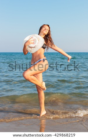 Happy young beautiful woman on the beach - stock photo