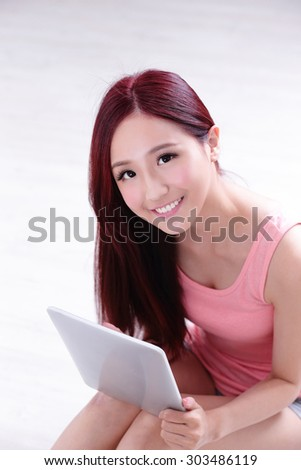 Happy young beautiful woman relax sitting and using digital tablet pc, asian beauty