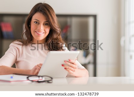 Happy Young Beautiful Woman Using Digital Tablet, Indoors - stock photo