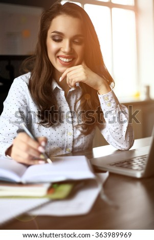 Happy Young Beautiful Woman Using Laptop, Indoors. - stock photo