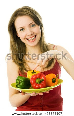 happy young beautiful woman with a lot of colorful peppers
