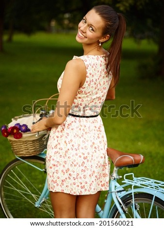 Happy Young Beautiful Woman With Bicycle In Park - stock photo