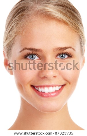 Happy young beautiful woman with healthy smile. Isolated over white background. - stock photo