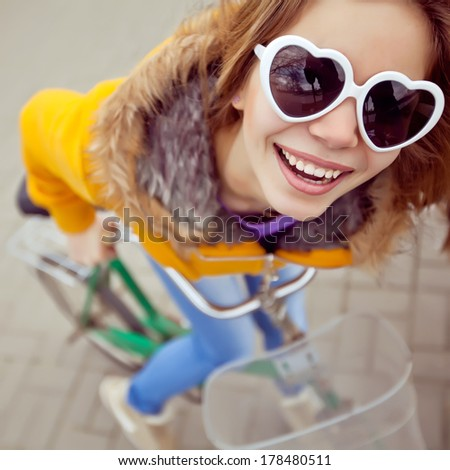 Happy young beautiful woman with retro bicycle, summer outdoor - stock photo
