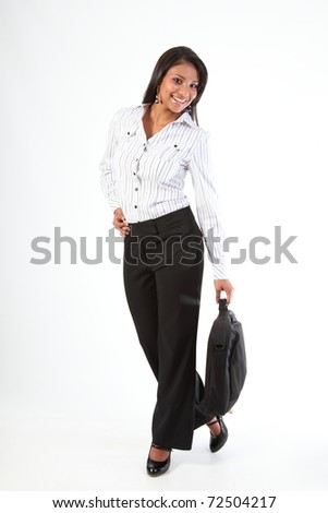 Happy young black business woman standing holding laptop bag
