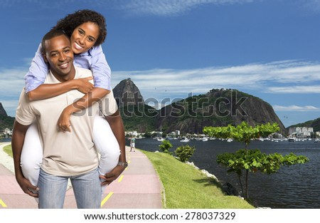 Happy Young Black couple looking at camera smiling in Rio de Janeiro