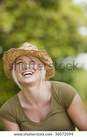 Happy young blond enjoying in the park - stock photo