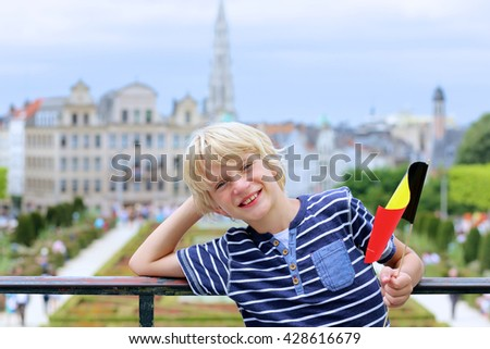 Happy young boy holding Belgian flag in Brussels, the capital of Belgium - stock photo