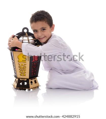 Happy Young Boy Hugging Ramadan Lantern Isolated on White Background - stock photo