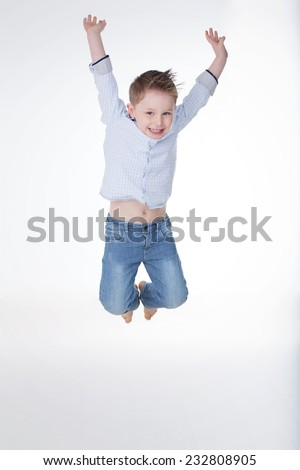 happy young boy jumping and laughing - stock photo