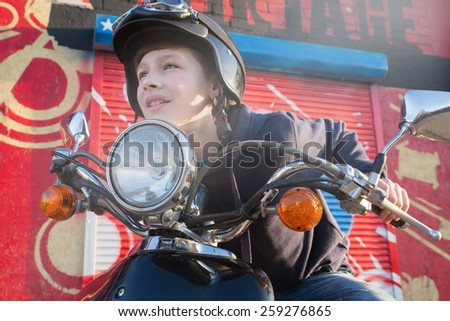 Happy young boy on scooter - stock photo